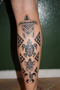 Polynesian Turtle tattoo arm tattoo